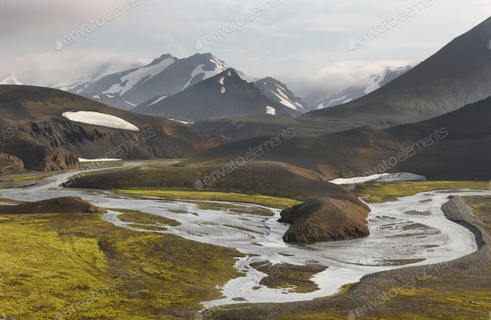 Icelandic landscape with river and mountains.