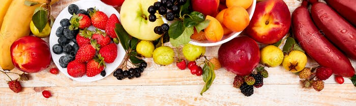 Banner with Flat lay of fruits over white wooden background