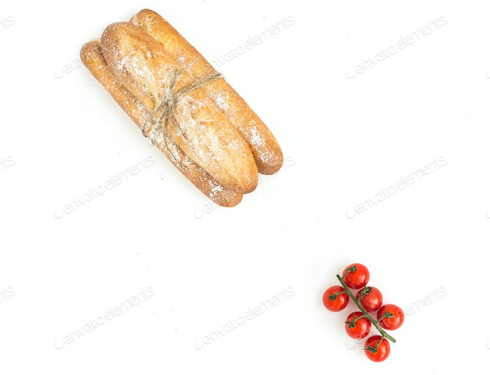 Freshly baked baguettes and cherry-tomatoes