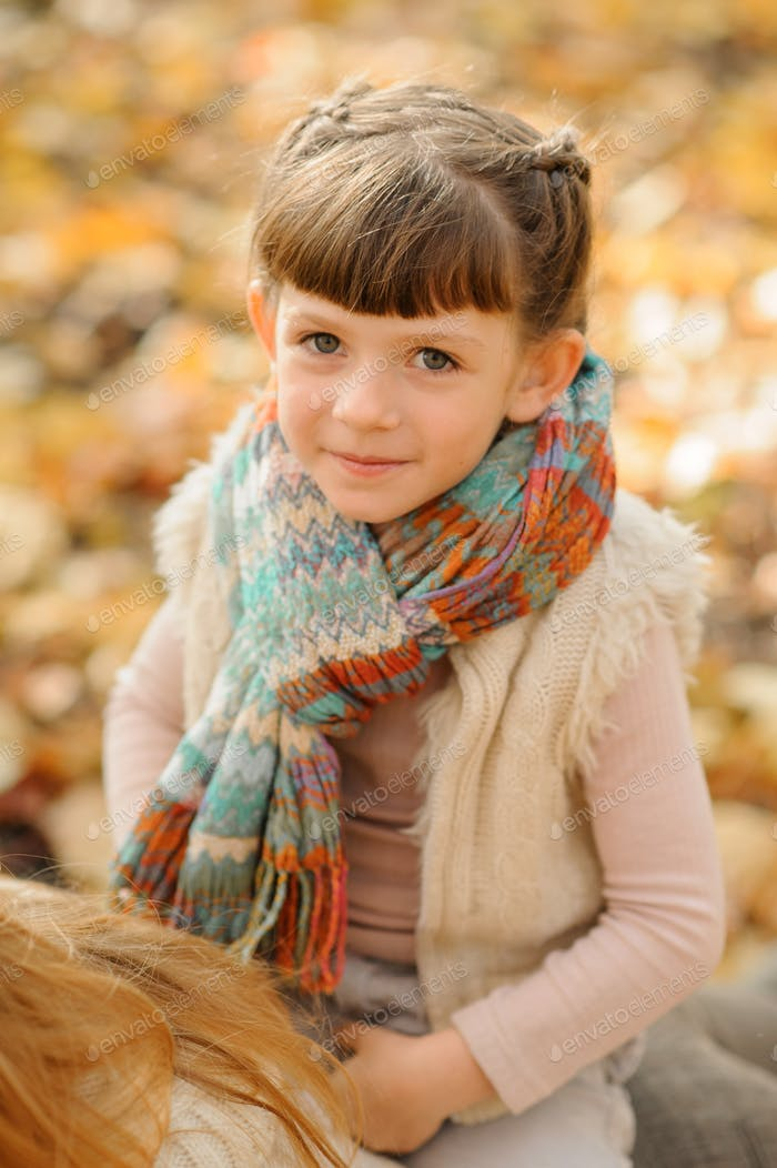 Close-up portrait of a little girl. Autumn time.