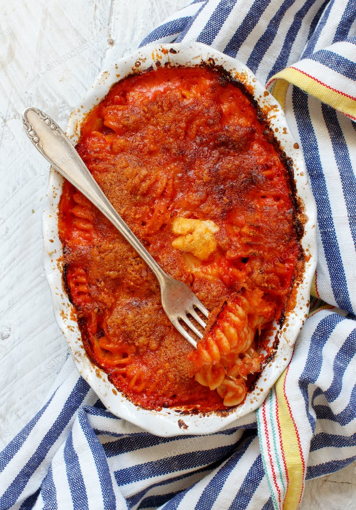 Baked pasta with tomato sauce and mozzarella cheese