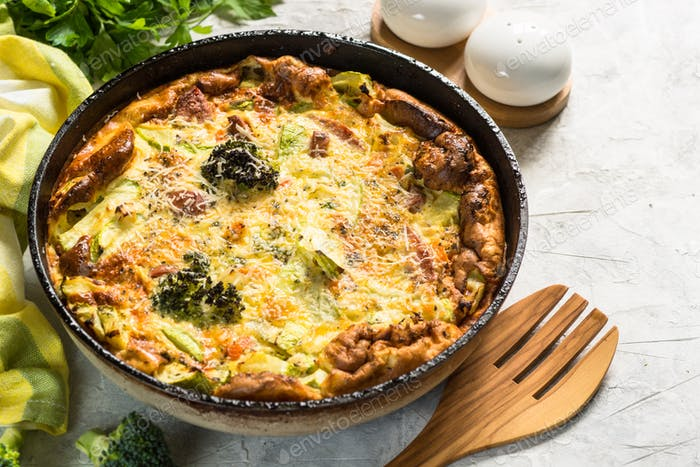Frittata with sausage and vegetables in skillet