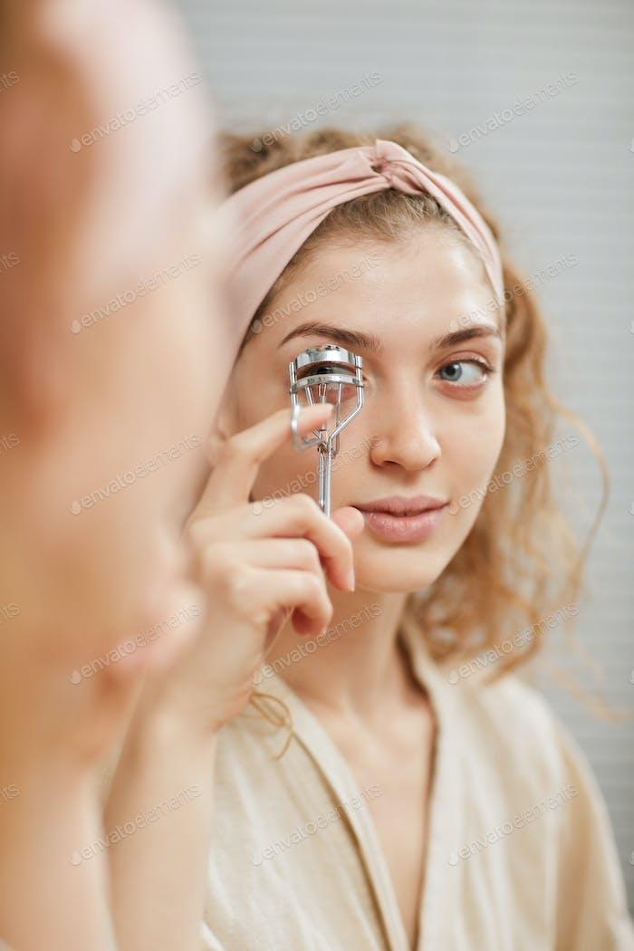Taking care of her eyelashes