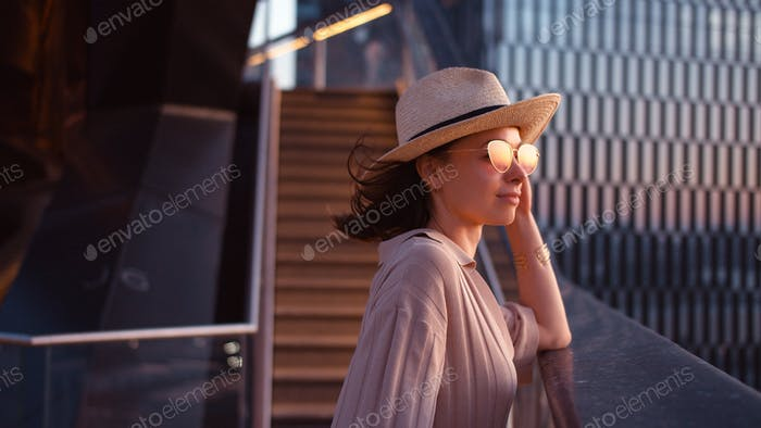 Beautiful girl in Vessel at sunset