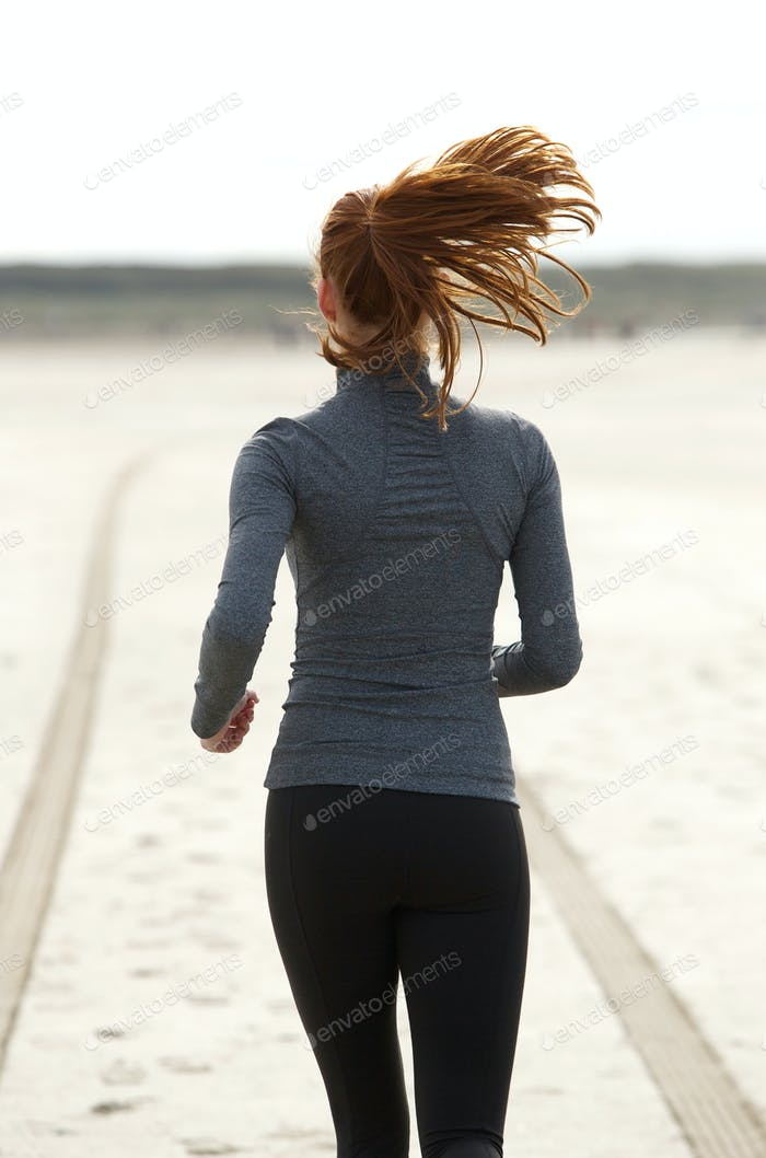 Rear view young woman running