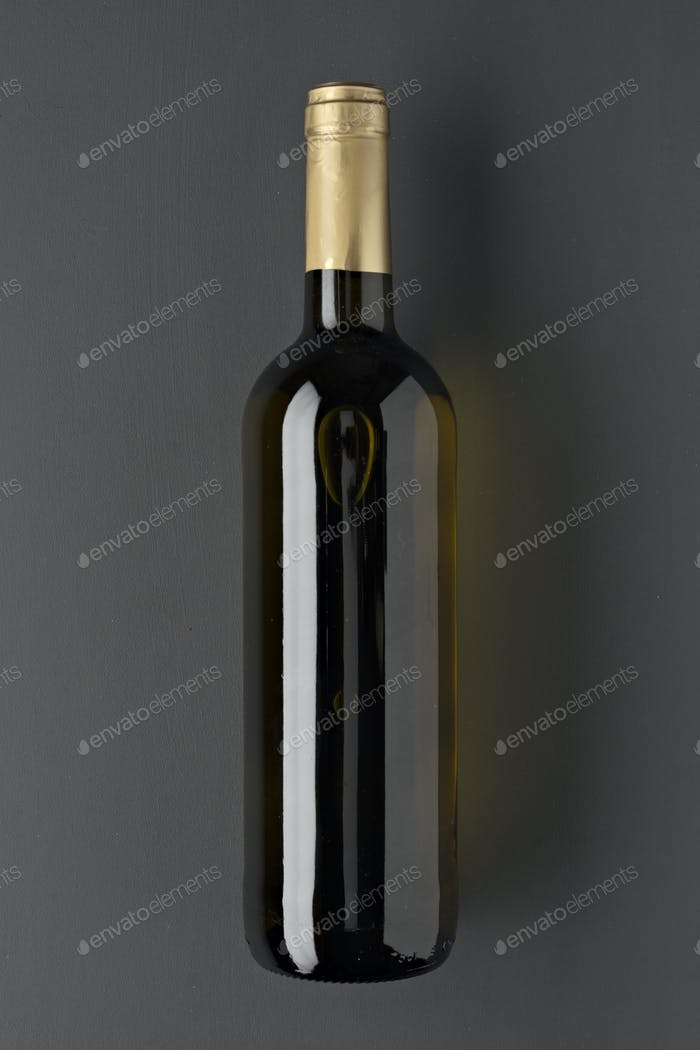 full bottles of spanish wine without labels on gray background