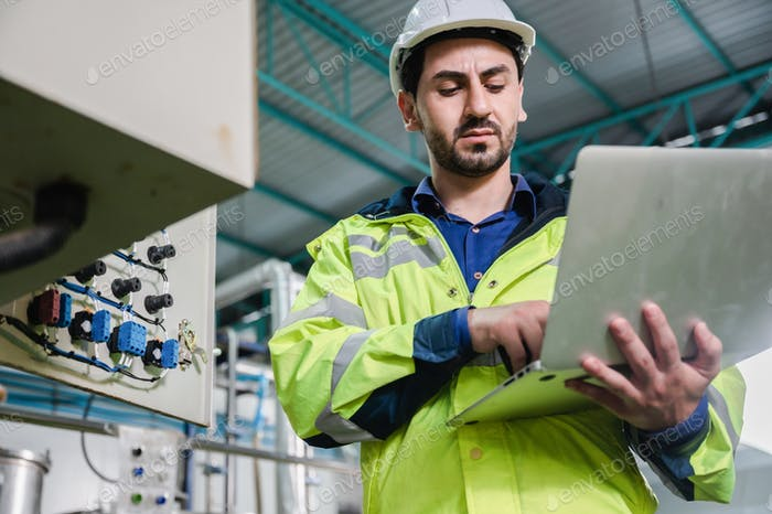 technician engineer working to maintenance a construction equipment industry, production technology