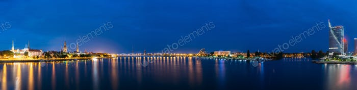 Riga Latvia. Panoramic Cityscape In Evening Illumination On Both