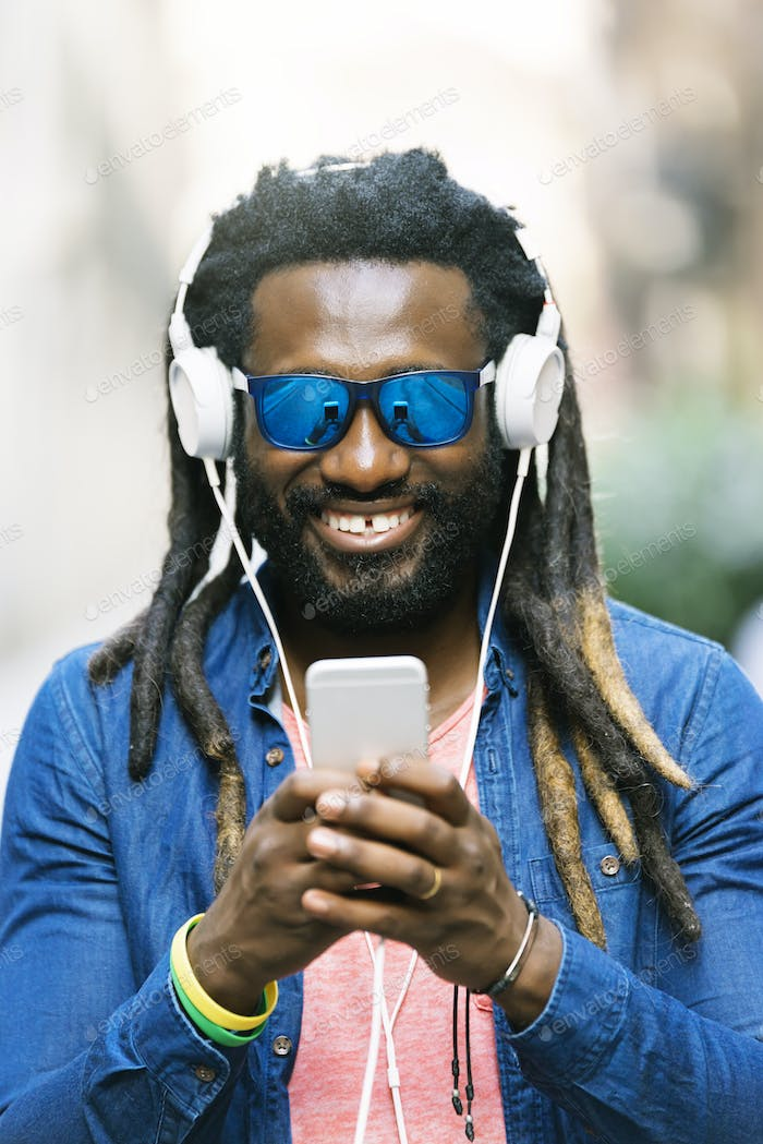 African Young Man Listening Music