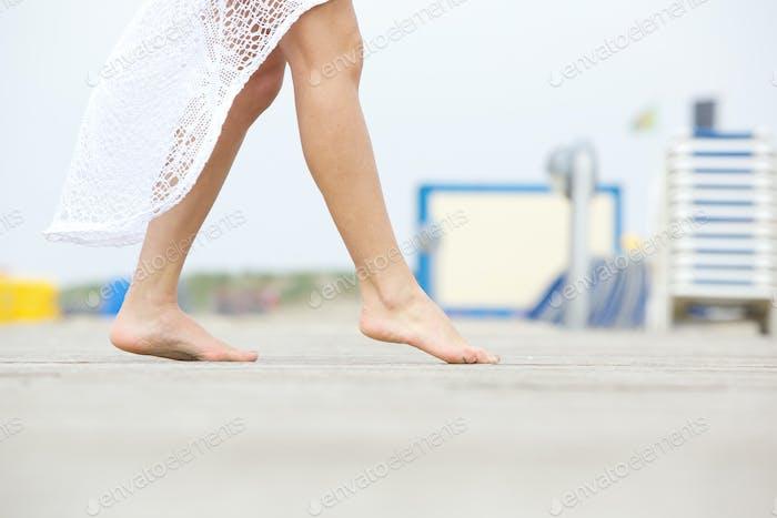 Walking barefoot outdoors