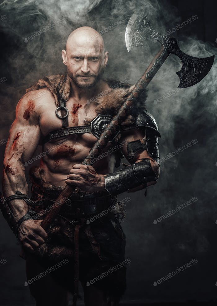 Armed with two handed axe dangerous bald viking warrior