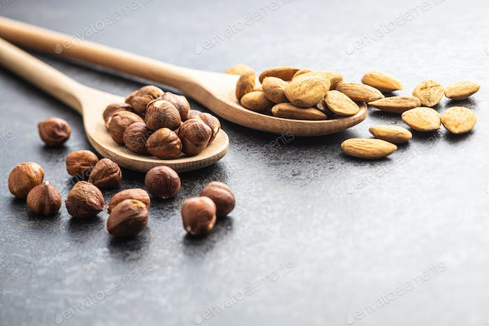 Dried almonds and hazelnuts in spoon