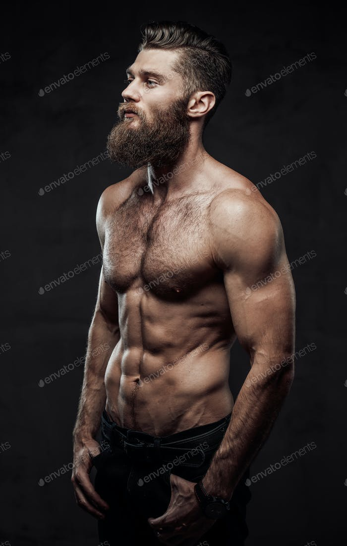 Bearded guy with naked torso posing in dark background