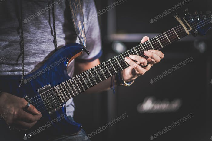 Caucasian Electric Guitarist