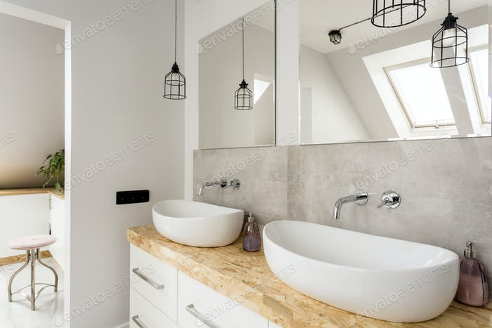 Minimalist bathroom with two sinks