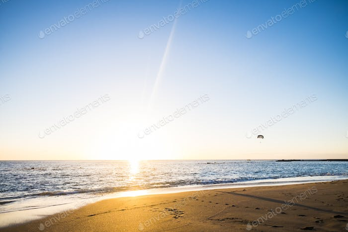 beach landscape with gloden and blue sky colors during sunset in amazing sandy shore