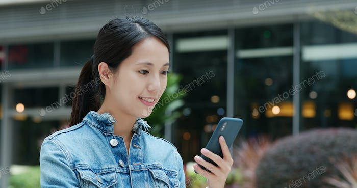 Woman send sms on cellphone