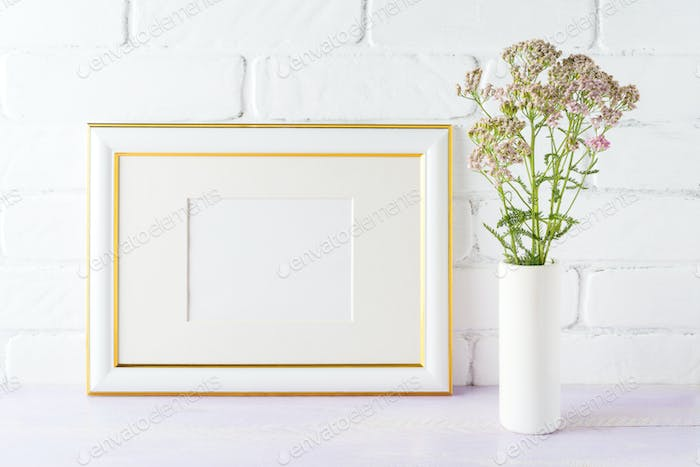 Gold decorated landscape frame mockup with wild creamy pink flow