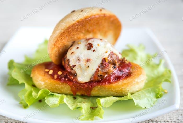 Sandwich with meatball in tomato sauce and mozzarella
