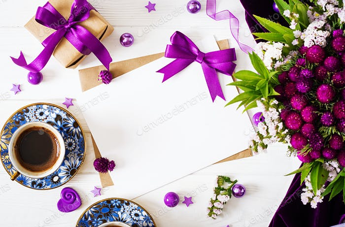 Mockup. Cards and flowers, box gift, violet ribbon, morning cup coffee