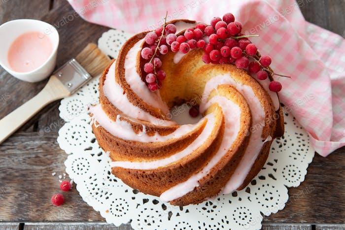 Tasty bundt cake with pink frosting