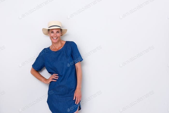 beautiful older woman smiling with hat against white background