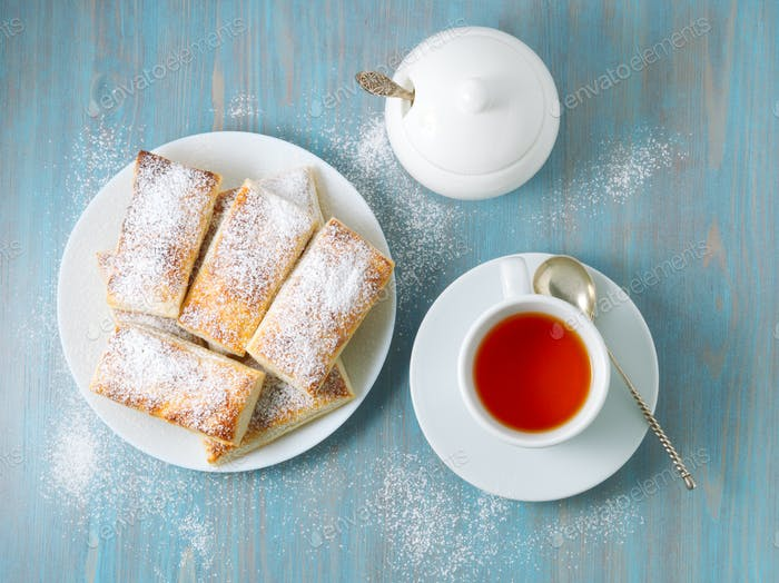 Delicious rolls from lush yeast-free puff pastry. Breakfast with cup of tea
