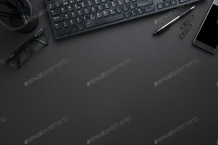 Computer Keyboard With Eyeglasses And Office Supply On Gray Desk