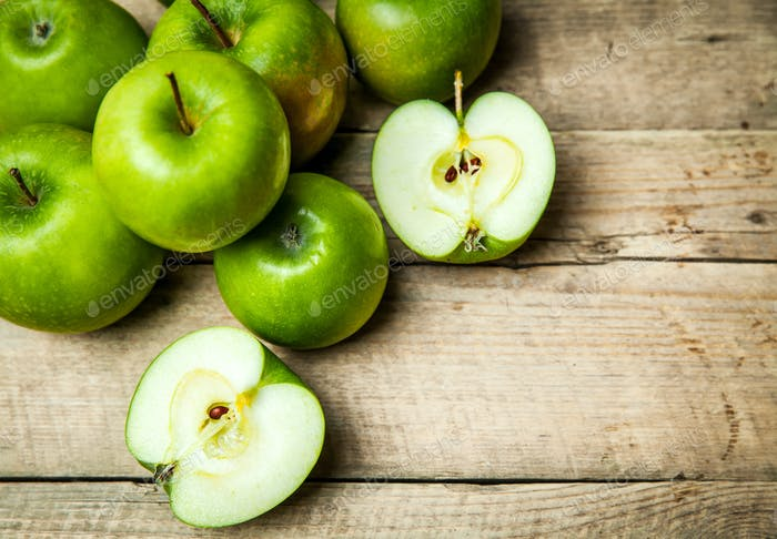 fruit. Ripe green apples on wooden background