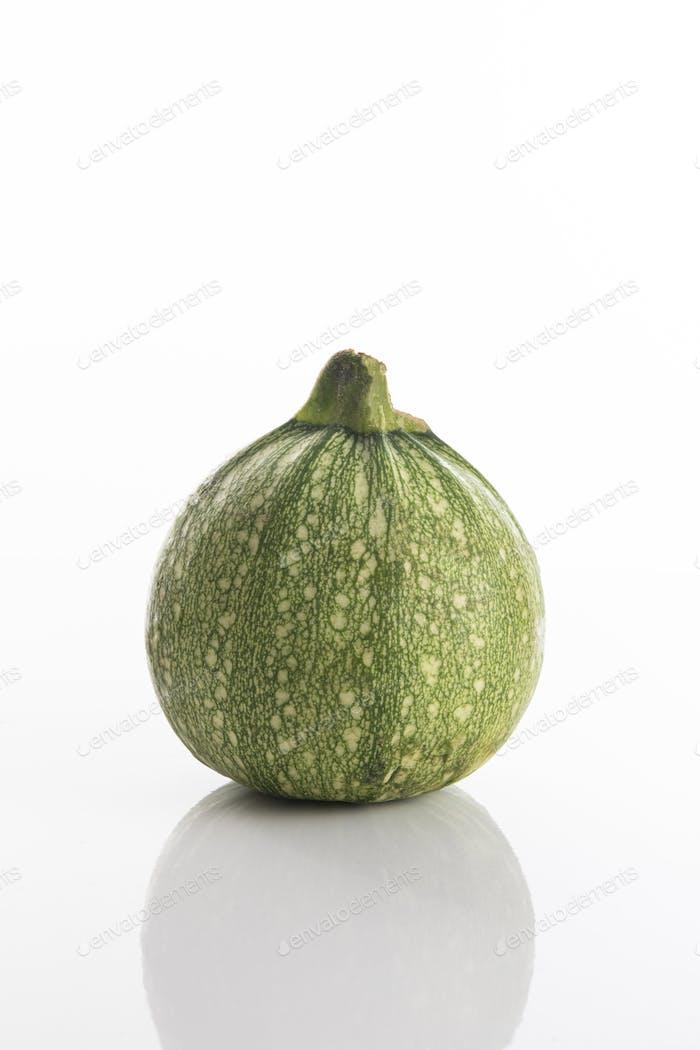 Fresh Round zucchini on a white background
