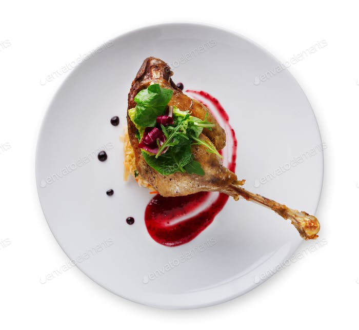 Duck confit with berry sauce isolated on white