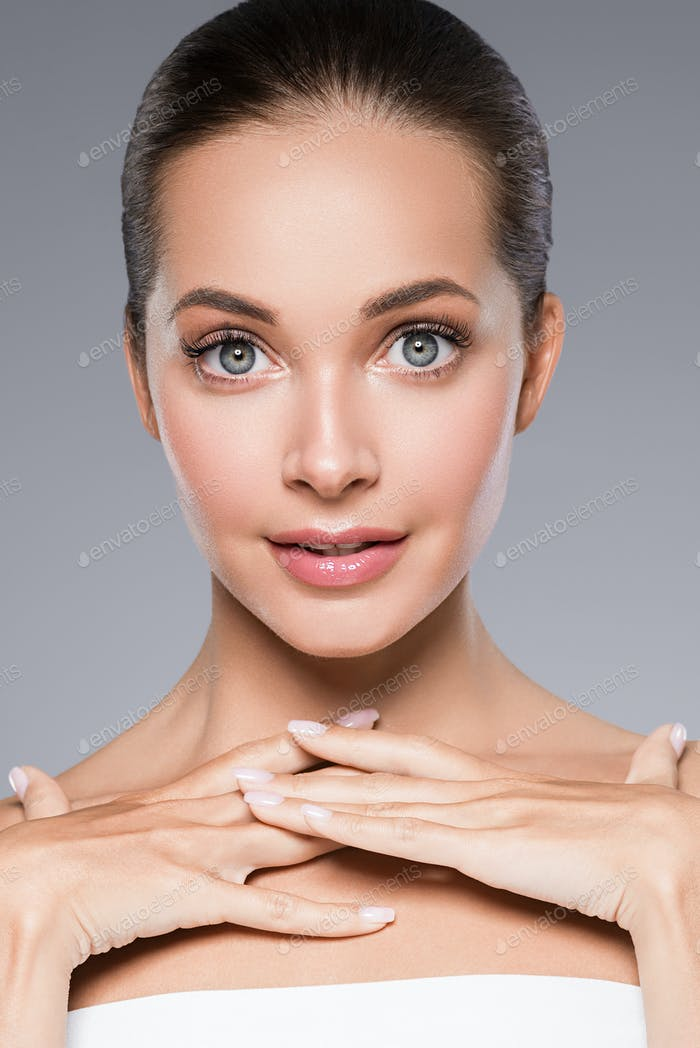 Beauty skin woman face skin cosmetic natural makeup happy model emotional face manicure nails hand