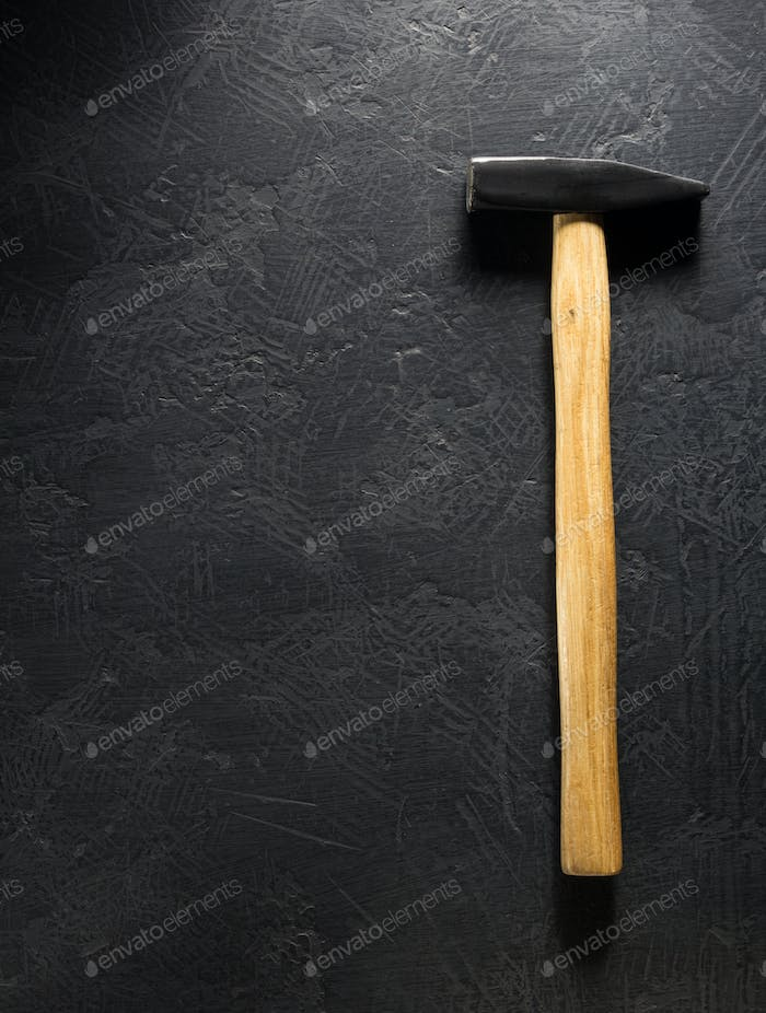 hammer tool at black background