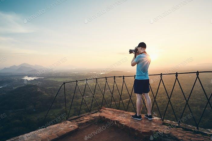Photographer on the top of Sigiriya rock