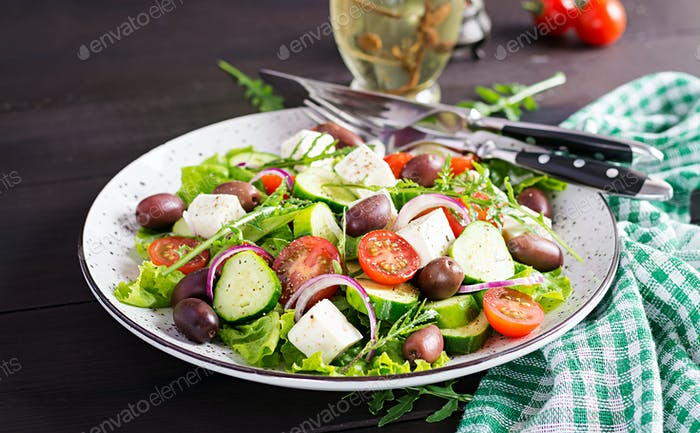 Greek salad with fresh vegetables, feta cheese and kalamata olives. Healthy food.