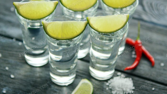 Tequila shots served on table