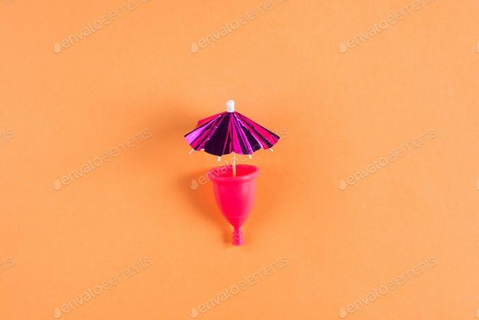 Pink menstrual cup. Menstruation concept