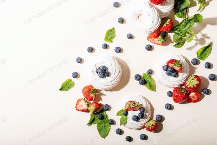 Dessert pavlov with strawberries and blueberries