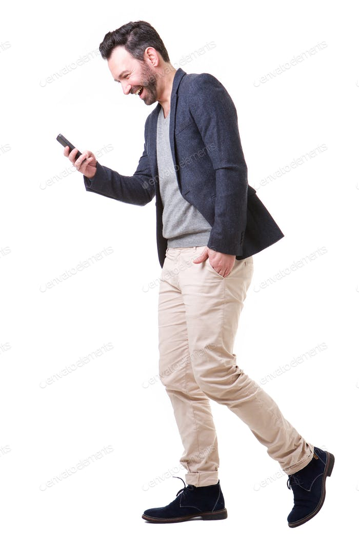side portrait of happy man looking at cellphone
