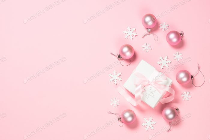 Christmas flat lay background with christmas present and decorations on pink