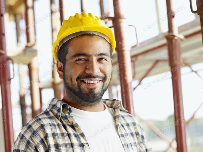 Portrait Of Hispanic Construction Worker In Building Site