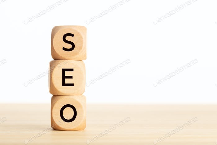 SEO word in wooden blocks on table