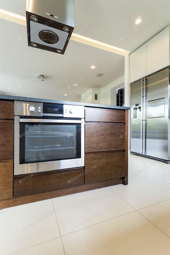 Elegant wooden kitchen island with oven