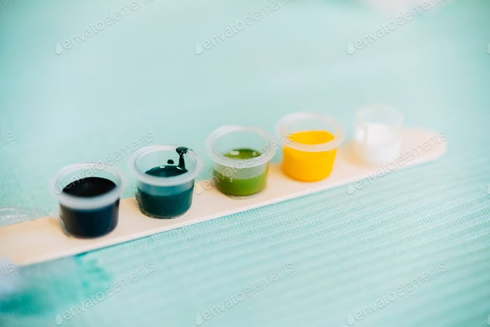 Little tattoo ink bottles full of different colors