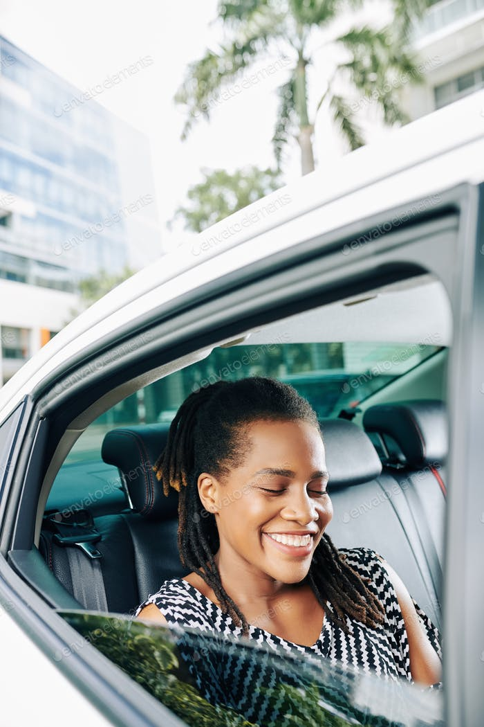 Happy woman using a taxi