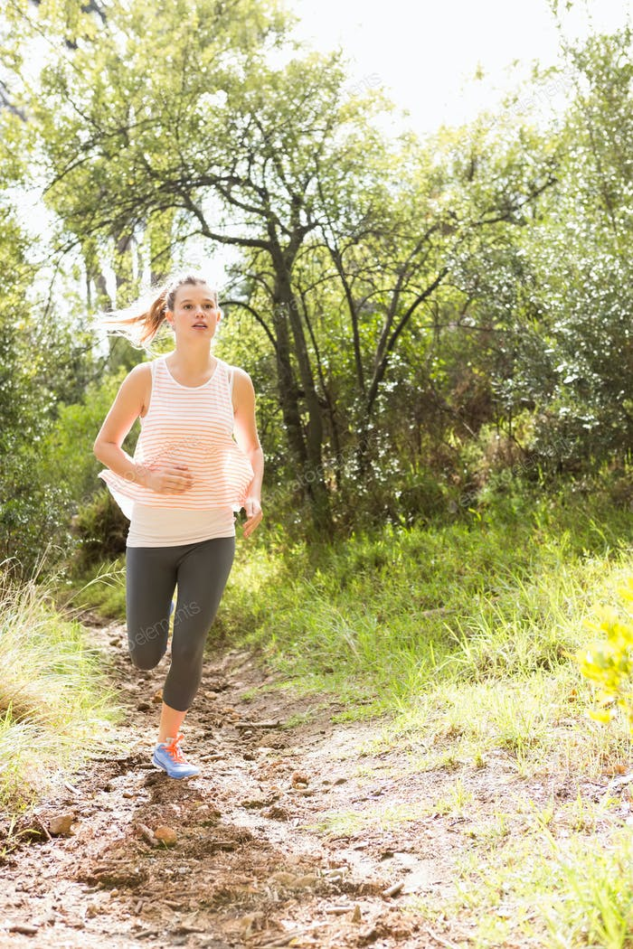 Thumbnail for Blonde athlete jogging on trail in the nature
