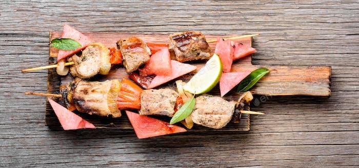 Shish kebab with watermelon garnish