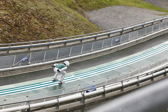 Ski jump. Artificial track. Winter sport. Norwegian summer. Horizontal