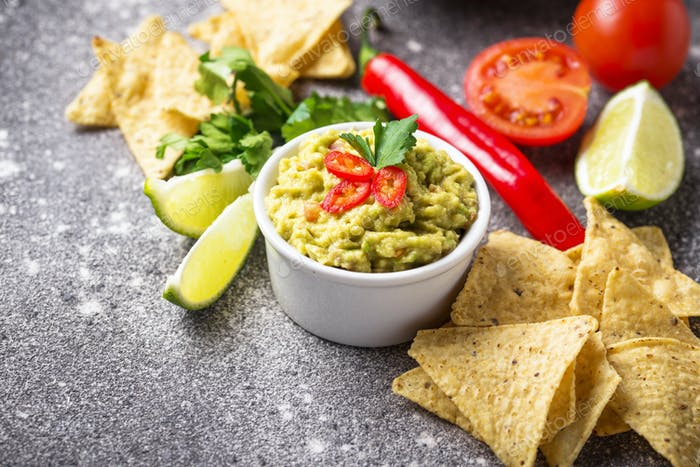 Avocado sauce guacamole with corn chips nachos