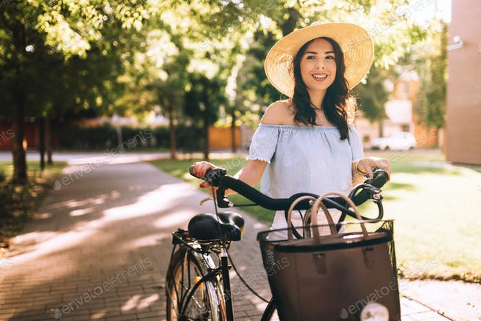 Beautiful woman using bicycle